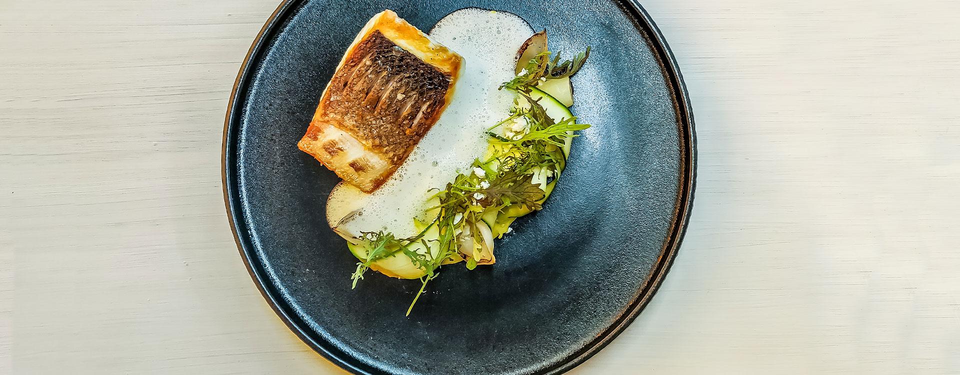 Amara Restaurant   Seared Sea Bass, served with Pistachio Cream, White Asparagus and Sparkling Wine Beurre Blanc